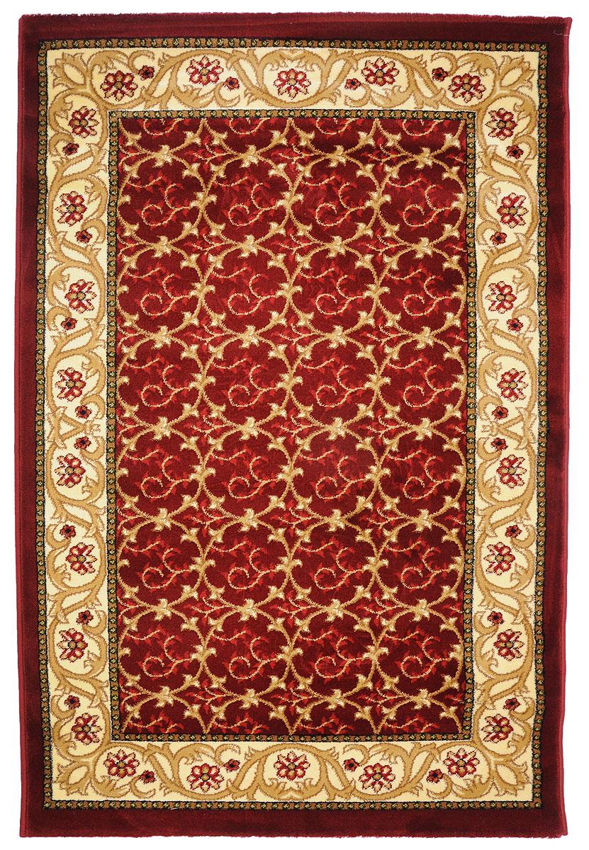 Ковер Kamalak Tekstil, прямоугольный, 100 x 150 см. УК-0221УК-0221Ковер Kamalak Tekstil изготовлен из прочного синтетического материала heat-set, улучшенного варианта полипропилена (эта нить получается в результате его дополнительной обработки). Полипропилен износостоек, нетоксичен, не впитывает влагу, не провоцирует аллергию. Структура волокна в полипропиленовых коврах гладкая, поэтому грязь не будет въедаться и скапливаться на ворсе. Практичный и износоустойчивый ворс не истирается и не накапливает статическое электричество. Ковер обладает хорошими показателями теплостойкости и шумоизоляции. Оригинальный рисунок позволит гармонично оформить интерьер комнаты, гостиной или прихожей. За счет невысокого ворса ковер легко чистить. При надлежащем уходе синтетический ковер прослужит долго, не утратив ни яркости узора, ни блеска ворса, ни упругости. Самый простой способ избавить изделие от грязи - пропылесосить его с обеих сторон (лицевой и изнаночной). Влажная уборка с применением шампуней и моющих средств не противопоказана. Хранить рекомендуется в свернутом рулоном виде.