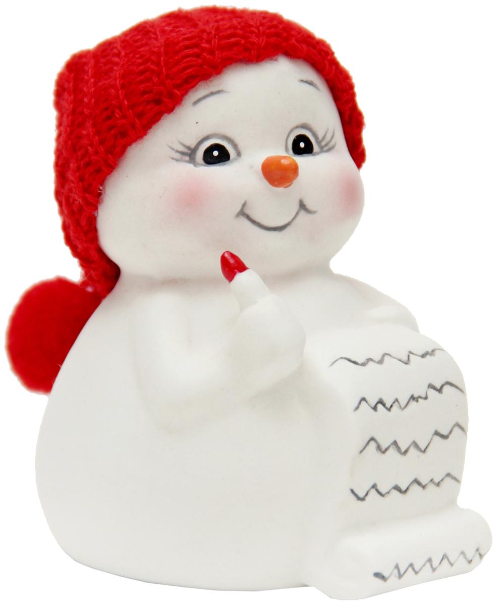 Фигурка новогодняя Magic Time Снеговик и список подарков, высота 8 см41746Новогодняя декоративная фигурка Magic Time Снеговик и список подарков прекрасно подойдет для праздничного декора вашего дома. Сувенир изготовлен из керамики в виде забавного снеговика. Такая оригинальная фигурка красиво оформит интерьер вашего дома или офиса в преддверии Нового года. Создайте в своем доме атмосферу веселья и радости, украшая его всей семьей красивыми игрушками, которые будут из года в год накапливать теплоту воспоминаний.