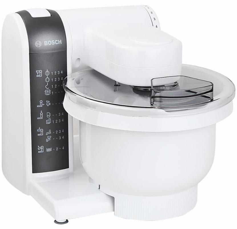 Bosch MUM 4855 кухонный комбайнMUM4855Кухонный комбайн Bosch MUM 4855: качество Bosch и широкий выбор аксессуаров. Широкий ассортимент насадок: венчик для замешивания жидкого теста, круглый венчик для взбивания крема и яичных белков, насадка для замешивания крутого теста, универсальная резка с тремя дисками для разных типов нарезки, мясорубка, блендер и подставка-держатель для аксессуаров. MultiMotion Drive: идеальное смешивание ингредиентов благодаря планетарному принципу вращения насадок. Прост в использовании и безопасен. Аксессуары можно мыть в посудомоечной машине. 4-ступенчатая регулировка скорости вращения, функция парковки (остановка принадлежностей в заданном положении). Многофункциональный рычаг для крепления насадок в разных положениях с тремя валами привода. Чаша для замешивания из пластика, возможность замеса до 2,7 кг теста (1 кг муки + ингредиенты), полупрозрачная крышка с отверстием для загрузки. Крюк для теста, венчик для жидкого теста, венчик для взбивания. Универсальная резка с 3 режущими дисками (двусторонняя терка, двусторонняя шинковка, терка для сыра/ шоколада/орехов). Блендер из пластика 1 л. Мясорубка. Интерактивный DVD диск с рецептами блюд. Подставка для принадлежностей. Отсек для кабеля. Высочайший стандарт безопасности благодаря защите от перегрузки. Резиновые ножки-присоски. Возможность доукомплектовать различными принадлежностями.