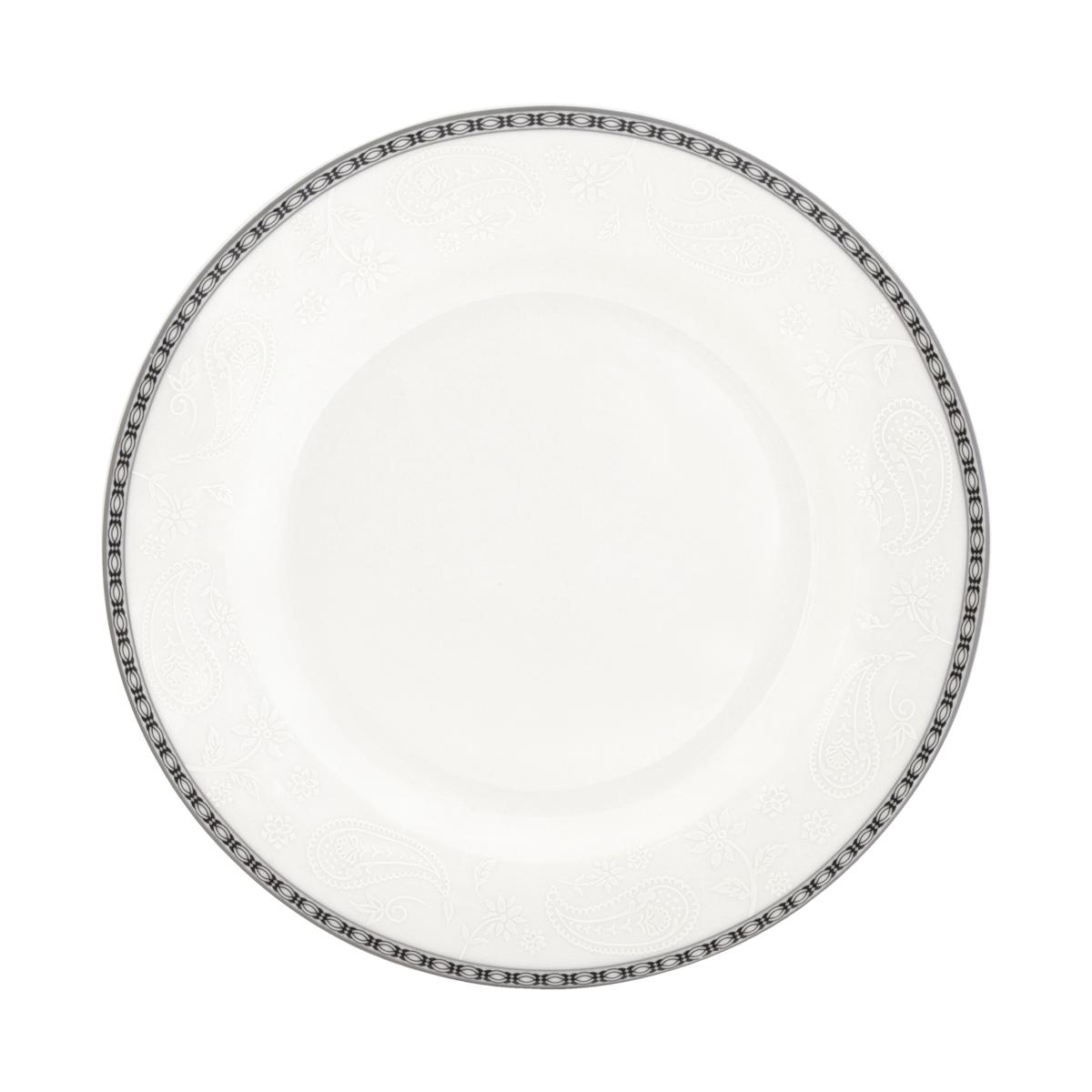 Набор суповых тарелок Esprado Arista White, диаметр 23 см, 6 шт. ARW023WE301ARW023WE301Набор Esprado Arista White состоит из шести суповых тарелок, декорированных изысканной каймой с орнаментом и тиснением с принтом пейсли. Посуда выполнена из костяного фарфора, основные составляющие которого костная зола и каолин. От содержания костной золы зависит белизна и прозрачность фарфора. В материале, который используется для создания посуды Esprado, его содержание от 48 до 50%.Родина костной золы, из которой производится посуда Esprado, Великобритания, славящаяся сырьем высокого качества. Каолин, белая глина на основе природного минерала, поступает из Новой Зеландии, одного из наиболее экологически чистых регионов мира. Такое сочетание обеспечивает высокое качество материала и безупречный оттенок слоновой кости. Экологическая глазурь из Японии, высоко ценящаяся во всем мире, которой покрывается готовое изделие, позволяет добиться идеально ровного цвета и кристального блеска. В костяном фарфоре отсутствуют примеси кадмия и свинца, а потому он абсолютно нетоксичен и безопасен. Посуда из фарфора Esprado прочна и устойчива к истиранию: царапины от ножа и сеточки трещин не появятся на ней даже через несколько лет. Серия Arista названа в честь первой правящей династии королевства Наварра - современной провинции Наварра в Северной Испании и Атлантических Пиренеев в современной Южной Франции. Аристократическая роскошь и непринужденная элегантность отличает каждый предмет коллекции. Белый цвет тождественен солнечному свету, а свет - это божество, благо, жизнь, полнота бытия. Белизна также является символом высокого общественного положения - благородства, величия, благосостояния. Столовая посуда Arista White, выполненная в ослепительном белом цвете и дополненная изящным платиновым декором, идеальный выбор для создания атмосферы аристократического приема за вашим столом.Можно использовать в микроволновой печи и мыть в посудомоечной машине.