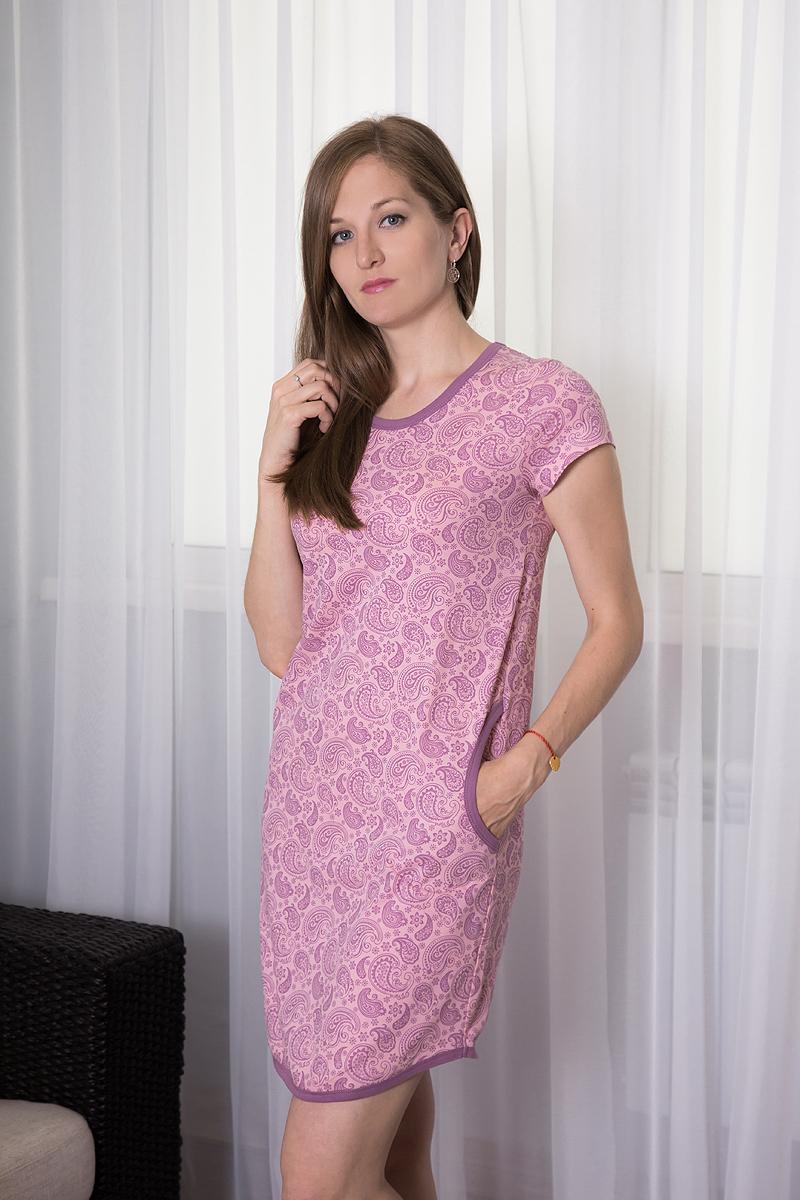 Платье домашнее Violett, цвет: розовый, лиловый. 7117110711. Размер XL (50)7117110711Домашнее платье Violett выполнено из натурального хлопка. Платье-миди с круглым вырезом горловины и короткими рукавами оформлено оригинальным цветочным принтом. Спереди расположены два втачных кармана.
