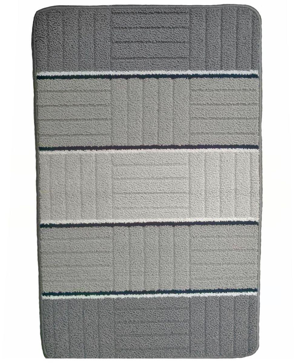 Коврик для ванной Kamalak Tekstil, цвет: серый, 60 x 100 см. УКВ-1002УКВ-1002Ковры-паласы выполнены из полипропилена. Ковры обладают хорошими показателями теплостойкости и шумоизоляции. Являются гиппоалергенными. За счет невысокого ворса ковры легко чистить. Вам придется по душе широкая гамма цветов и возможность гармонично оформить интерьер. Практичный и устойчивый к износу ворс - от постоянного хождения не истирается, не накапливает статическое электричество. Структура волокна в полипропиленовых моделях гладкая, поэтому грязь не может выесться, на ворсе она скапливается с трудом. Полипропилен не впитывает влагу, отталкивает водянистые пятна. Уход: Самый простой способ избавить изделие от грязи – пропылесосить его с обеих сторон (лицевой и изнаночной).Влажная уборка с применением шампуней и моющих средств не противопоказана. Если шерсти и шёлку универсальные чистящие составы не подходят, то для синтетики они придутся в самый раз.Хранить их нужно рулоном, не складывая «салфеткой».При надлежащем уходе синтетический ковёр прослужит долго, не утратив ни яркости узора, ни блеска ворса, ни его упругости.