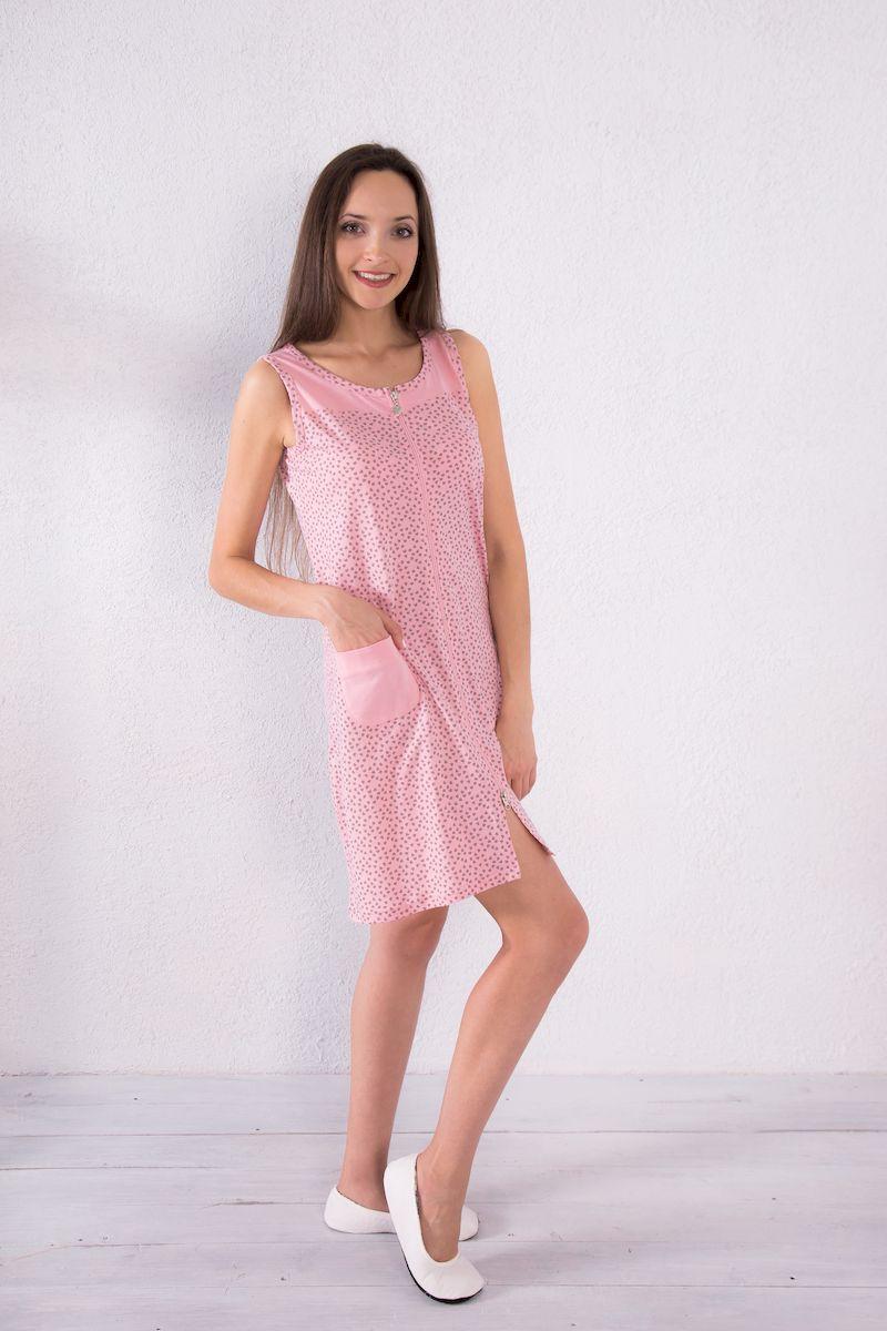 Халат женский Violett, цвет: розовый. 7117110124. Размер M (46)7117110124Женский халат Violett выполнен из натурального хлопка. Халат с круглым вырезом горловины застегивается на застежку-молнию. Спереди расположен один накладной карман. Модель оформлена принтом в виде сердечек.