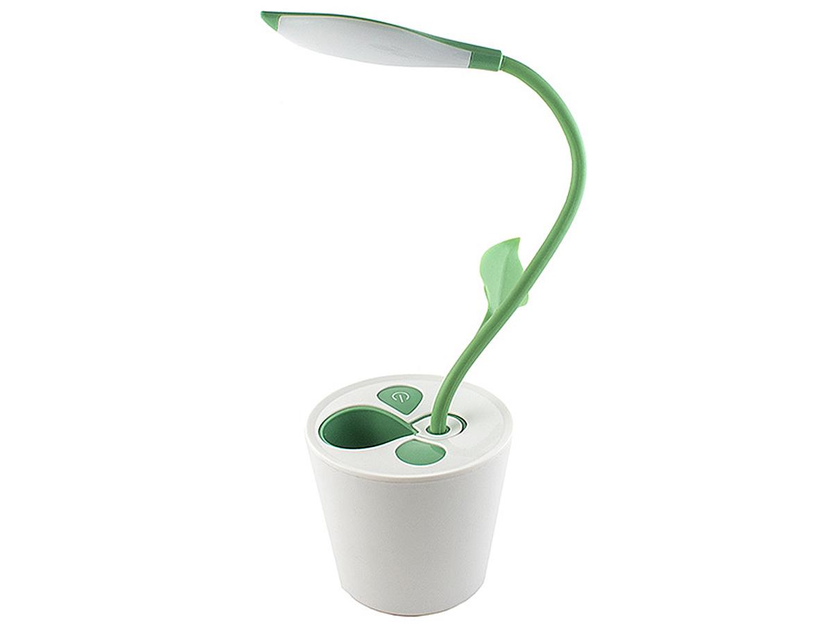 Светильник настольный Эврика Саженец97468Светильник на гибкой ножке удачно имитирует горшечное растение. В углу верхнего листика расположена светодиодная лампа, помогающая работать за столом в тёмное время суток. Гнущийся стебель-ножка позволяет настроить освещение под нужным углом. В основании горшка находится емкость, которую можно использовать для хранения ручек, карандашей и других канцелярских мелочей Светильник имеет возможность подключения к USB-порту вашего компьютера.Материал: пластик, силикон.Упаковка: картонная коробка.