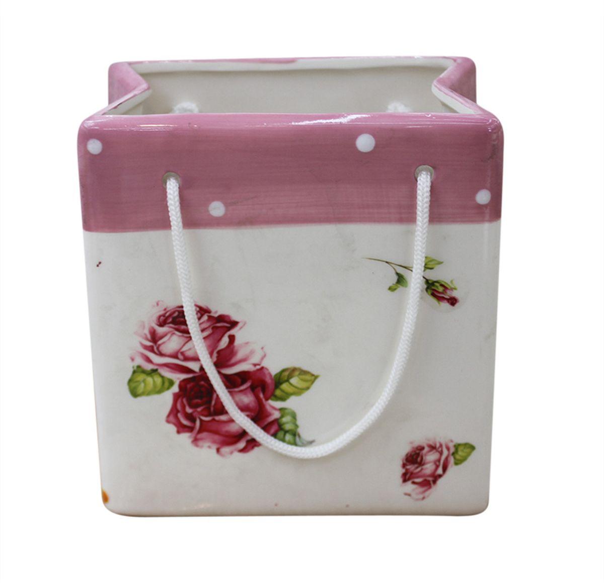 Ваза N/A Пакетик, высота 8,5 смYX12BG38-3RAЭлегантная ваза N/A Пакетик, изготовленная из керамики, выполнена в виде подарочного пакетика с ручками. Такое оформление делает ее изящным украшением интерьера.Ваза N/A Пакетик дополнит интерьер офиса или дома и станет желанным и стильным подарком.Размер вазы: 8 х 5,5 х 8,5 см.