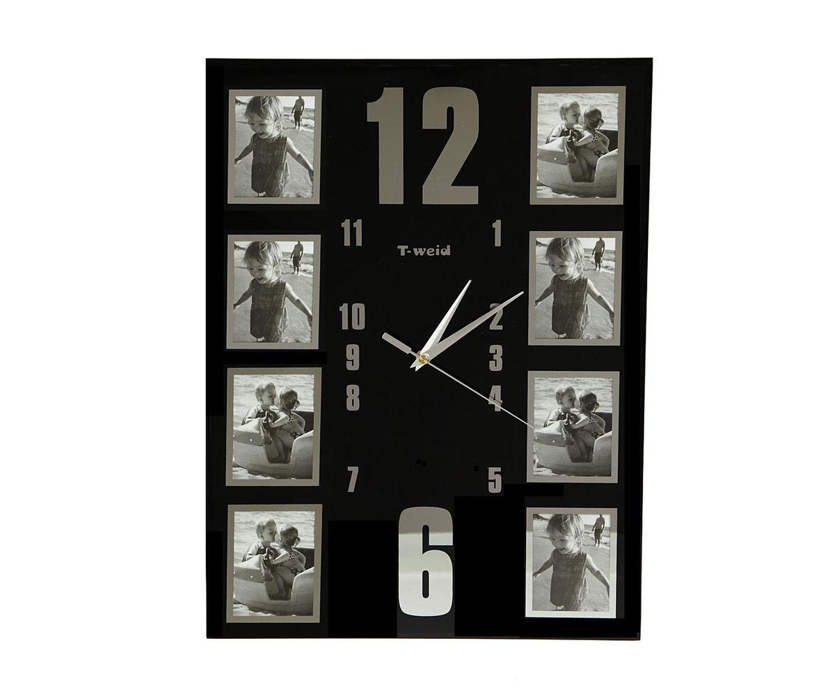 Часы настенные T-Weid, с фоторамками, цвет: черный, 34 х 45 х 5 смM 9084Настенные кварцевые часы T-Weid с фоторамками - это прекрасный предмет декора, а также универсальный подарок практически по любому поводу. Корпус часов, выполнен из прочного черного стекла и оформлен восемью фоторамками в серебристой окантовке.Циферблат часов оснащен тремя фигурными стрелками: часовой, минутной и секундной. На задней стенке часов расположена металлическая петелька для подвешивания и блок с часовым механизмом. Часы с фоторамками прекрасно впишутся в любой интерьер. В зависимости оттого, что вы поместите в рамки, будет меняться и стиль часов. Тип механизма: плавающий, бесшумный. Рекомендуется докупить батарейку типа АА (не входит в комплект). Для 8 фото 7 х 9 см.