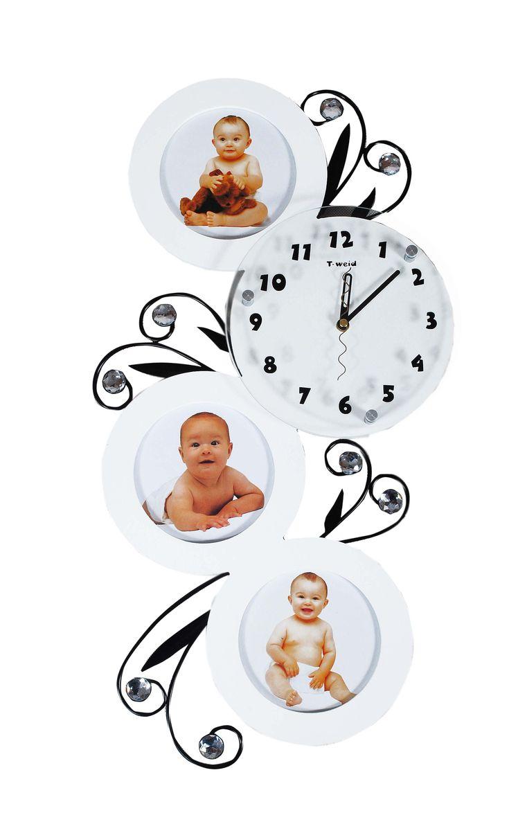 Часы настенные T-Weid, с фоторамками, цвет: белый, 32 х 59 х 5 смM 2028 B WhiteНастенные кварцевые часыT-Weid с фоторамками - это прекрасный предмет декора, а также универсальный подарок практически по любому поводу. Корпус часов, выполнен из дерева с белым матовым покрытием, декорирован изображениями металлических веток с листьями и украшен стразами, так же оформлен тремя круглыми фоторамками. Циферблат часов оснащен тремя фигурными стрелками: часовой, минутной и секундной. Циферблат и стрелки защищены прочным стеклом, который крепится четырьмя металлическими крепежами к корпусу. На задней стенке часов расположена металлическая петелька для подвешивания и блок с часовым механизмом. Часы с фоторамками прекрасно впишутся в любой интерьер. В зависимости оттого, что вы поместите в рамки, будет меняться и стиль часов. Тип механизма: плавающий, бесшумный. Рекомендуется докупить батарейку типа АА (не входит в комплект). Для 3 фото 13 х 13 см.