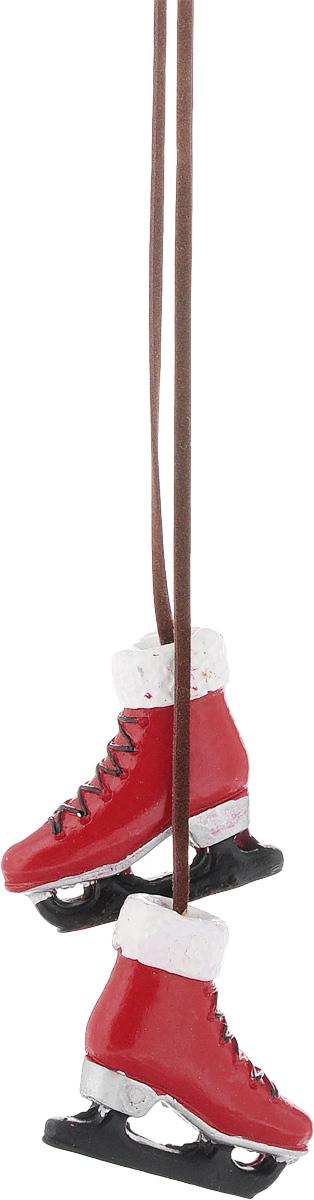 Украшение новогоднее подвесное Magic Time Коньки, цвет: красный, длина 48,5 см. 4181141811/75387Новогоднее подвесное украшение Magic Time Конькивыполнено в виде двух полирезиновых фигурок, которые соединены текстильным шнуром. Украшение можноповесить в любом понравившемся вам месте. Но,конечно,удачнее всего оно будет смотреться на праздничнойелке. Елочная игрушка - символ Нового года. Она несет в себеволшебство и красоту праздника. Создайте в своем домеатмосферу веселья и радости, украшая новогоднюю елкунарядными игрушками, которые будут из года в годнакапливать теплоту воспоминаний. Размер фигурок: 4 х 1 х 3,5 см.
