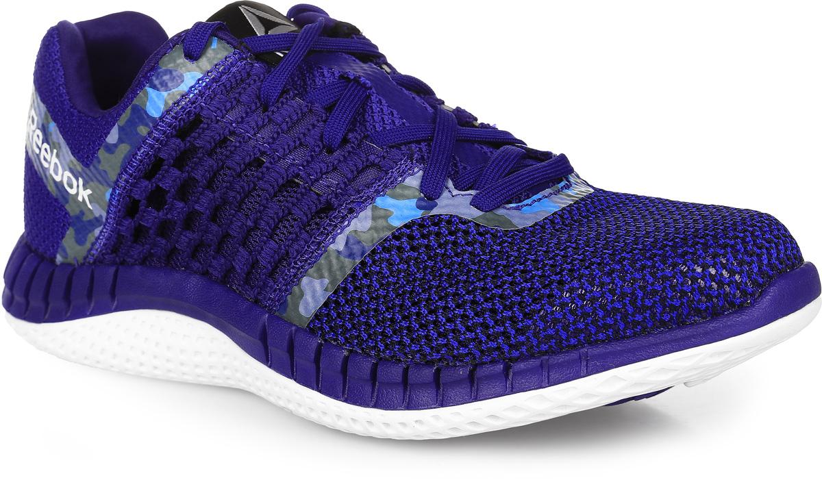Кроссовки для бега женские Reebok Zprint Run Camo GpPigment, цвет: синий. AR2757. Размер 8,5 (40)AR2757Кроссовки Reebok Zprint Run Camo GpPigment выполнены из вязаного текстиля и оформлены элементами с камуфляжным принтом. Язычок оформлен фирменной нашивкой. На ноге модель фиксируется с помощью шнурков. Внутренняя поверхность выполнена из сетчатого текстиля, который обеспечивает воздухообмен. Стелька выполнена из мягкого ЭВА-материала с текстильной поверхностью. Подошва изготовлена из легкой и пластичной резины. Также подошва оснащена протектором, который обеспечит отличное сцепление с любой поверхностью.