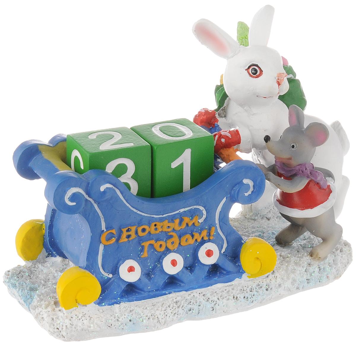 Супенир-календарь новогодний Magic Time Зайчик с подарками, 15 х 8 х 9,5 см41722Новогодний сувенир-календарь Magic Time Зайчик с подарками изготовлен из полирезины. Изделие выполнено в виде зайчика и мышонка с подарками около саней, в которые устанавливаются два кубика с числами. Оригинальный календарь Magic Time Зайчик с подарками гармонично впишется в праздничный интерьер вашего дома или офиса.