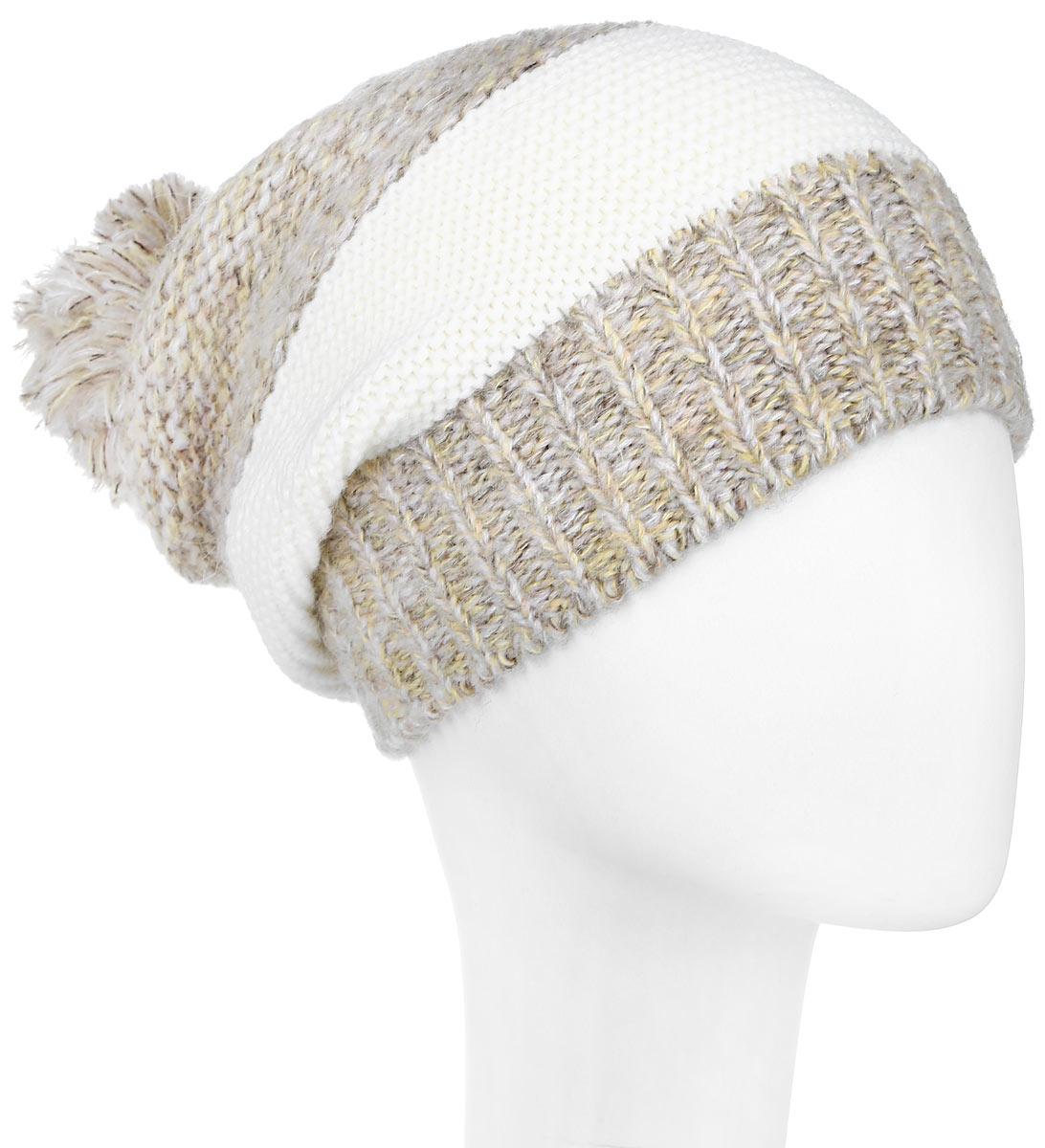 Шапка женский Dispacci, цвет: бежевый, молочный. 21120M. Размер универсальный21120MСтильная женская шапка Dispacci, изготовленная из мягкой итальянской пряжи смешанного состава, она обладает хорошими дышащими свойствами и хорошо удерживает тепло. Элегантная шапка немного удлиненная и свободная в макушке дополнена пушистым помпоном. Практичная форма модели делает ее очень комфортной, а маленькая аккуратная металлическая пластина с названием бренда подчеркивает ее оригинальность.