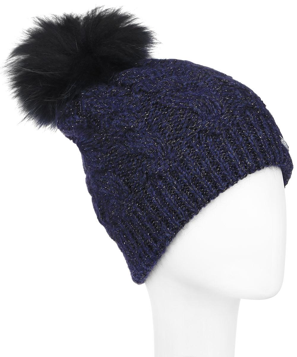 Шапка женская Dispacci, цвет: темно-синий. 21111S. Размер универсальный21111SСтильная женская шапка Dispacci, изготовленная из мягкой пряжи смешанного состава, она обладает хорошими дышащими свойствами и хорошо удерживает тепло. Элегантная шапка оформлена крупной вязкой с узорами и дополнена блестящим стильным люрексом. На макушке изделие дополнено помпоном из натурального меха. Практичная форма шапки делает ее очень комфортной, а маленькая аккуратная металлическая пластина с названием бренда подчеркивает ее оригинальность.
