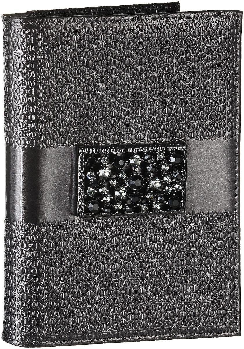 Обложка для автодокументов женская Elisir Mirella, цвет: серый, черный. BV3-216EL-NK216-BV0013-000Обложка для автодокументов Elisir Мirella выполнена излаковой натуральной кожи и оформлена брошью из кристаллов Swarovski. Внутри изделие имеет четыре кармана для кредиток и два открытых кармана из кожи, съемный блок для документов, включающий в себя шесть прозрачных файлов, один из которых формата А5. Изделие поставляется в фирменной упаковке. Обложка для автодокументов поможет сохранить внешний вид ваших документов и защитить их от повреждений, а также станет стильным аксессуаром.