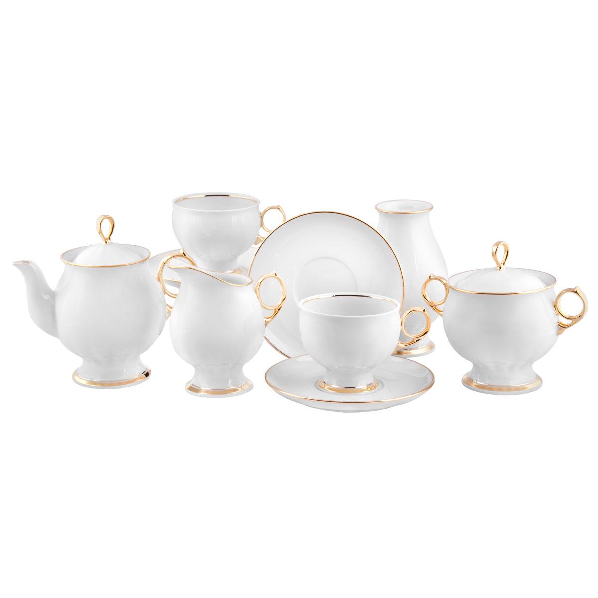Сервиз чайный Башфарфор Золотая ручка, 16 предметовСЧН 12.16.2.Ж11Сервиз чайный из белого фарфора рассчитан на 6 персон. Тонкий белый фарфор украшен золотым орнаментом. Удобная, практичная, легкая посуда, подходит и для особых случаев и на каждый день. В состав набора входит: чашка 250мл 6 шт, блюдце 14,5см 6 шт, сахарница 300мл 1шт, чайник 600мл 1 шт, Молочник 250мл 1шт, ваза 1шт.