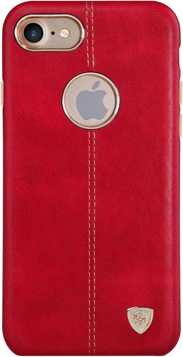Nillkin Englon Leather Cover чехол для Apple iPhone 7, Red2000000100258Чехол Nillkin Englon для Apple iPhone 7 надежно защищает ваш смартфон от внешних воздействий, грязи, пыли, брызг. Он также поможет при ударах и падениях, не позволив образоваться на корпусе царапинам и потертостям. Внутри чехла встроена магнитная площадка для крепления к магнитным держателям. Чехол обеспечивает свободный доступ ко всем функциональным кнопкам смартфона и камере.