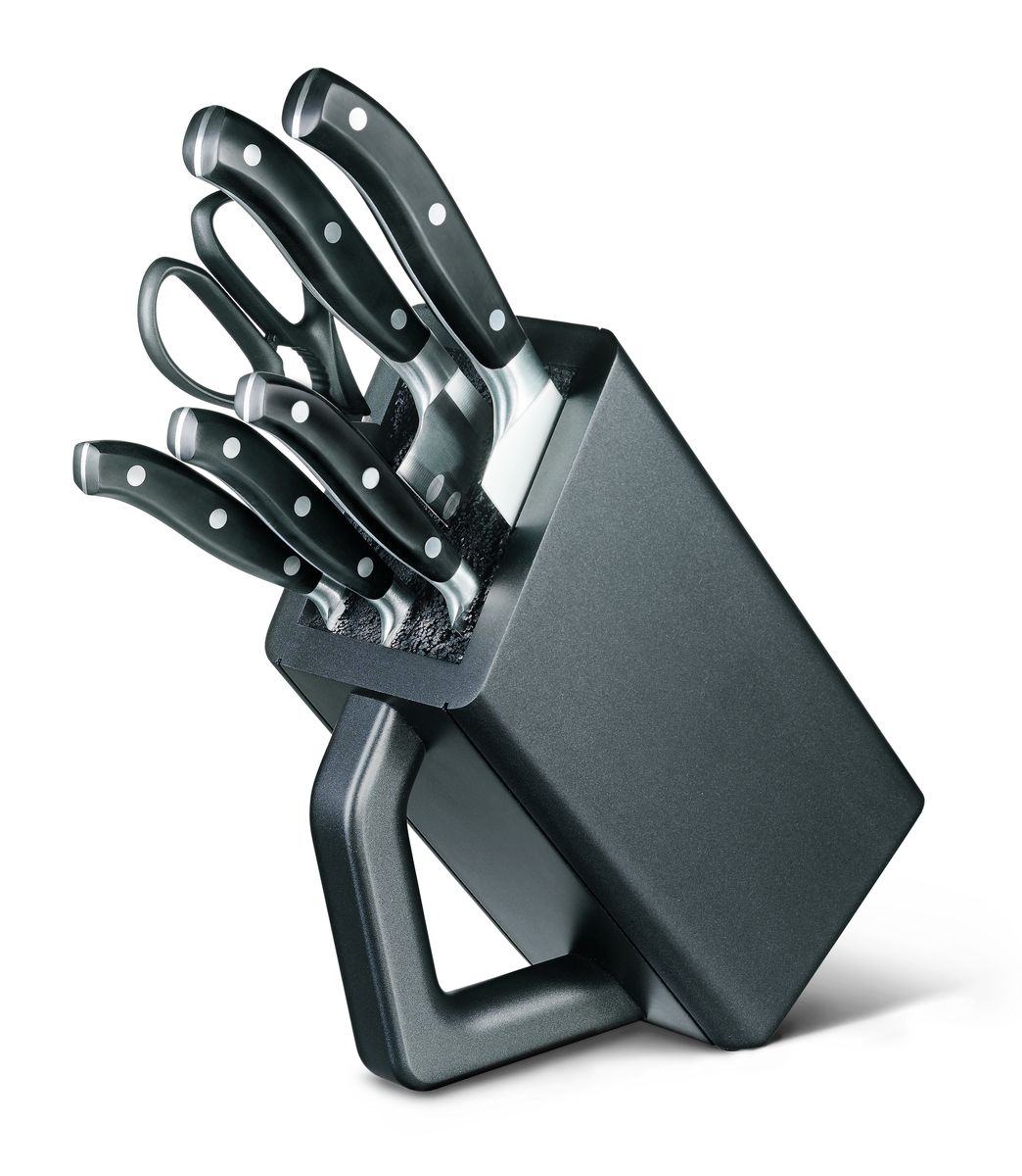 Набор кованых кухонных приборов Victorinox, на подставке, 7 предметов7.7243.6Кованые ножи Victorinox нравятся как любителям, так и профессиональным шеф-поварам. Баланс между рукоятью и лезвием идеально рассчитывается для того, чтобы обеспечить удобство использования даже не протяжение длительного времени работы с ножами. Все модели в данных сериях штампуются из одной детали и имеют бесшовный переход от лезвия к рукояти. Это удивительное качество и неподвластная времени элегантность делают кованые ножи Victorinox такими особенными. У кованых ножей также есть больстер — стальное утолщение в месте, где сходится рукоять и лезвие, он разработан специально, чтобы защитить вашу руку от соскальзывания с рукояти на лезвие. Как правило, ножи данной серии подходят для использования в посудомоечных машинах, тем не менее для увеличения срока службы рекомендуется мыть их в ручную. 6 предметов: - кухонные ножницы (7.6363.3) - нож для чистки овощей (7.7203.06) - нож для стейка (7.7203.12) - универсальный нож (7.7203.15) - нож Сантоку (7.7323.17) - нож шеф-повара (7.7403.20)