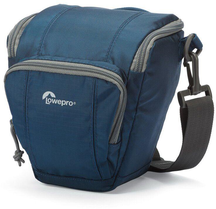 Lowepro Toploader Zoom 45 AW II, Blue сумка для фотокамерыLP36701-0RUВторое поколение сумок серии Toploader Zoom AW II предоставляют надежную защиту в течения дня на прогулке, в путешествие или при спортивной съемке. Компактные, оснащенные возможностью быстрого доступа к камере сумки, которые можно носить тремя способами (на плече, поясе или с помощью специальной разгрузочной системы Topload Chest Harness). Бегунки застежек-молний, которые легко открываются и закрываются при низких температурах, имеют специальные D-образные кольца: их просто нащупать, за них легко ухватиться. На светло-серой ткани отделки основного отсека сумок быстрее можно разглядеть нужную вещь.Все сумки серии оснащены встроенным всепогодным защитным чехлом All Weather AW Cover и вместительным фронтальным карманом на молнии для разных полезных мелочей, кошелька или документов