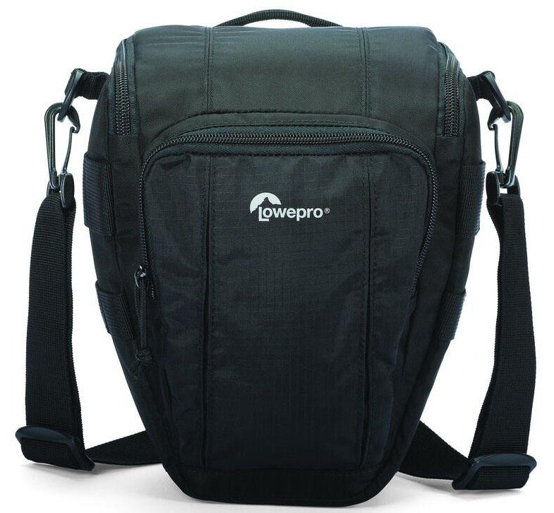 Lowepro Toploader Zoom 50 AW II, Black сумка для фотокамерыLP36702-0RUВторое поколение сумок серии Toploader Zoom AW II предоставляют надежную защиту в течения дня на прогулке, в путешествие или при спортивной съемке. Компактные, оснащенные возможностью быстрого доступа к камере сумки, которые можно носить тремя способами (на плече, поясе или с помощью специальной разгрузочной системы Topload Chest Harness). Бегунки застежек-молний, которые легко открываются и закрываются при низких температурах, имеют специальные D-образные кольца: их просто нащупать, за них легко ухватиться. На светло-серой ткани отделки основного отсека сумок быстрее можно разглядеть нужную вещь.Все сумки серии оснащены встроенным всепогодным защитным чехлом All Weather AW Cover и вместительным фронтальным карманом на молнии для разных полезных мелочей, кошелька или документов