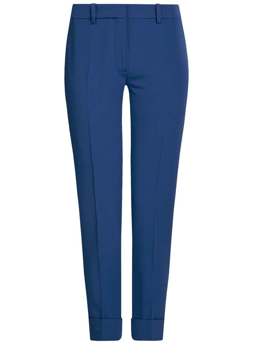 Брюки женские oodji Ultra, цвет: синий. 11703057-2/22398/7500N. Размер 40 (46-170)11703057-2/22398/7500NСтильные женские брюки oodji выполнены из комбинированного материала. Модель со средней посадкой застегивается на молнию, пуговицу и застежку-крючок, имеются шлевки для ремня. Спереди изделие дополнено имитацией двух втачных карманов, сзади двух врезных карманов. Низ брючин оформлен декоративными отворотами.