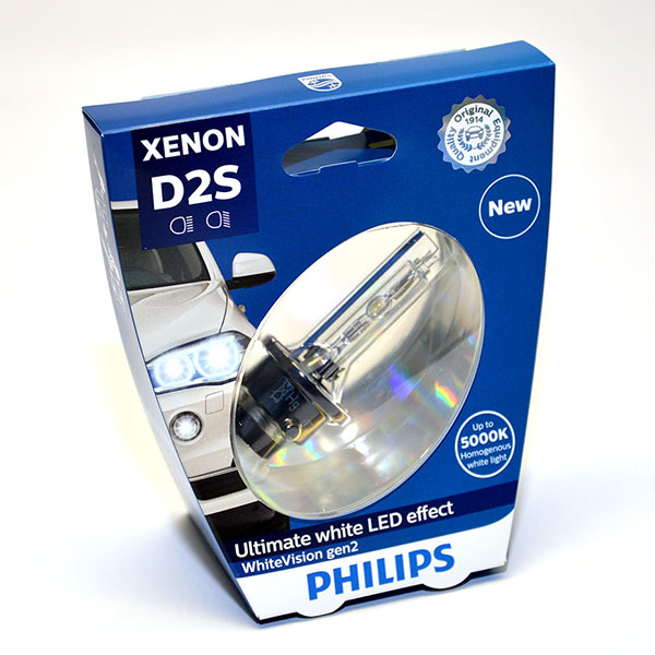 Лампа автомобильная ксеноновая Philips WhiteVision gen2, цоколь D2S, 85 Вт. 85122 WHV2S185122 WHV2S1? Мощный равномерный яркий белый свет ? Идеально сочетается со светодиодным освещением вашей машины? Белый свет до 5000K на дороге? Улучшение видимости на 120%*? Лампа, разрешенная для использования на дорогах общего пользованияС лампами Philips Xenon WhiteVision gen2 машина становится более заметной, а освещение дороги более ярким и равномерным. Xenon WhiteVision gen2 — идеальный выбор, если вы хотите сочетать ксенон со светодиодным освещением автомобиля.