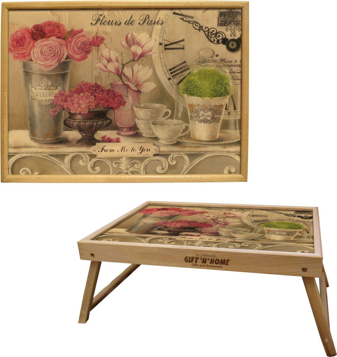 Столик с раскладными ножками GiftnHome Парижские цветы, 25 х 37,5 смTL-FleursСтолик-поднос с раскладными ножками GiftnHome Парижские цветы - это истинный комплимент вашим любимым и близким людям, он станет отличным подарком. Он выполнен из благородной породы древесины - бука. Подать кофе, завтрак в постель или вынести на веранду гостям закуски, фрукты сервированные на стильном подносе, с оригинальным принтом на поверхности.Изделие несомненно внесет свой Арт-стиль и уютную атмосферу в домашнее пространство. Нанесенные на столешницу дизайнерские принты прекрасно дополнят интерьер вашего дома, дачи, студии или городской кухни - это современные, актуальные изделия, выполненные с душой, и несущие в дом настроение.Высота столика: 15 см.
