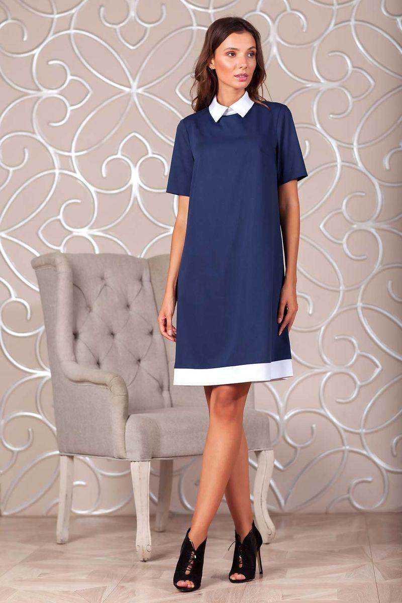 Платье Ruxara, цвет: темно-синий. 0113741. Размер 480113741Элегантное платье из ткани костюмной группы. Модель трапециевидного силуэта с коротким рукавом. Низ платья оформлен полосой контрастного цвета. Воротник отложной на стойке с застежкой на пуговицы сзади. В среднем шве спинки застежка на потайную молнию. Нежное платье поможет создать образы на разные случаи жизни.
