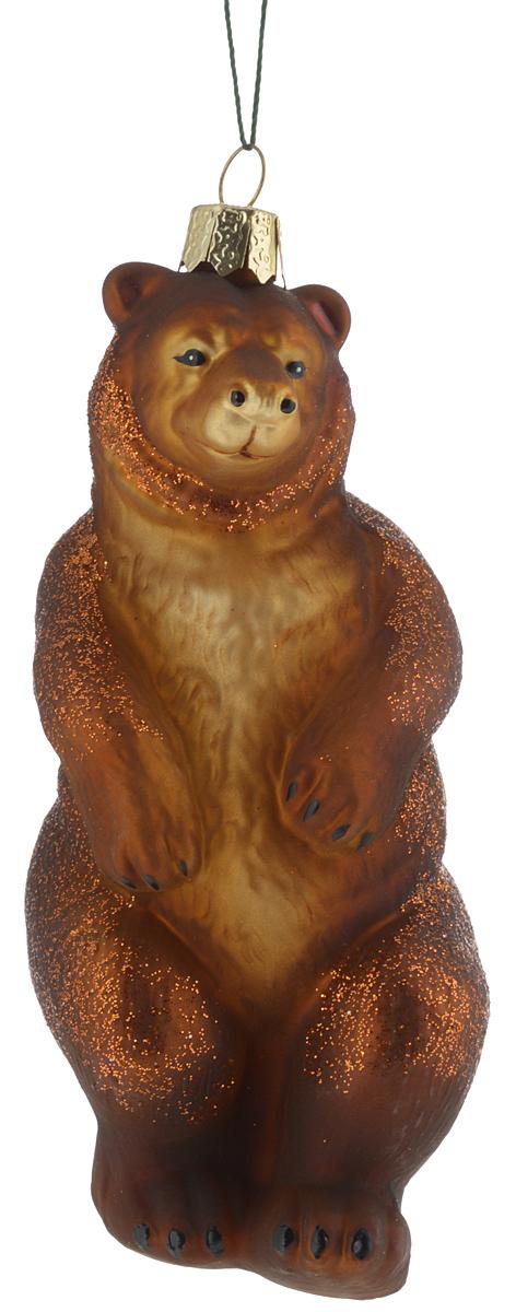 Украшение новогоднее подвесное Winter Wings Медведь, 13,5 х 6 х 5,5 смN07213Новогоднее подвесное украшение Winter Wings Медведь прекрасно подойдет для праздничного декора новогодней ели. Изделие выполнено из высококачественного стекла. Для удобного размещения на елке предусмотрена веревочка.Елочная игрушка - символ Нового года. Она несет в себе волшебство и красоту праздника. Создайте в своем доме атмосферу веселья и радости, украшая новогоднюю елку нарядными игрушками, которые будут из года в год накапливать теплоту воспоминаний. Откройте для себя удивительный мир сказок и грез. Почувствуйте волшебные минуты ожидания праздника, создайте новогоднее настроение вашим дорогим и близким.