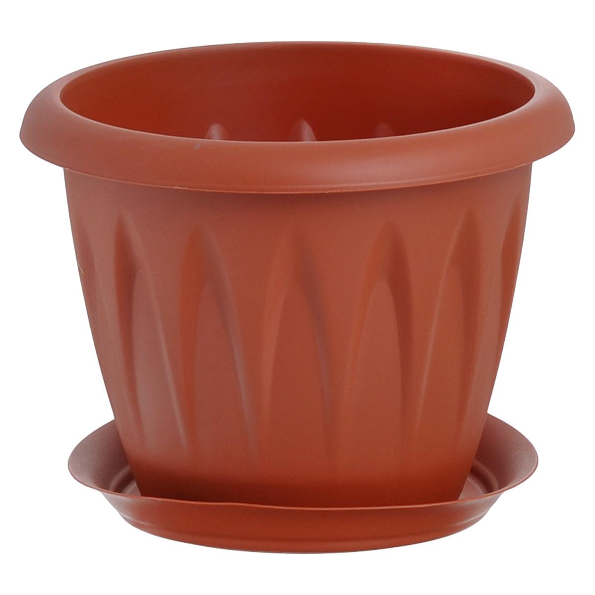 Кашпо Idea Алиция, с поддоном, цвет: терракотовый, 600 млМ 3063Кашпо Idea Алиция изготовлено из прочного полипропилена (пластика) и предназначено для выращивания растений, цветов и трав в домашних условиях. Круглый поддон обеспечивает сток воды. Такое кашпо порадует вас функциональностью, а благодаря лаконичному дизайну впишется в любой интерьер помещения. Диаметр кашпо по верхнему краю: 12 см. Высота кашпо: 9,5 см. Диаметр поддона: 9,5 см. Объем кашпо: 0,6 л.