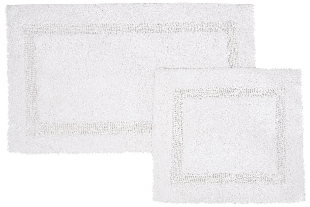 Набор ковриков для ванной Modalin Karla, цвет: белый, 2 шт5027/CHAR002Набор Modalin Karla, выполненный из высококачественного хлопка, состоит из двух ковриков для ванной комнаты. Изделия добавят тепло и уют, а также внесут неповторимый колорит в интерьер ванной комнаты. Высокая износостойкость ковриков и стойкость цвета позволит вам наслаждаться покупкой долгие годы.Размер большего коврика: 60 х 100 см.Размер малого коврика: 60 х 50 см.