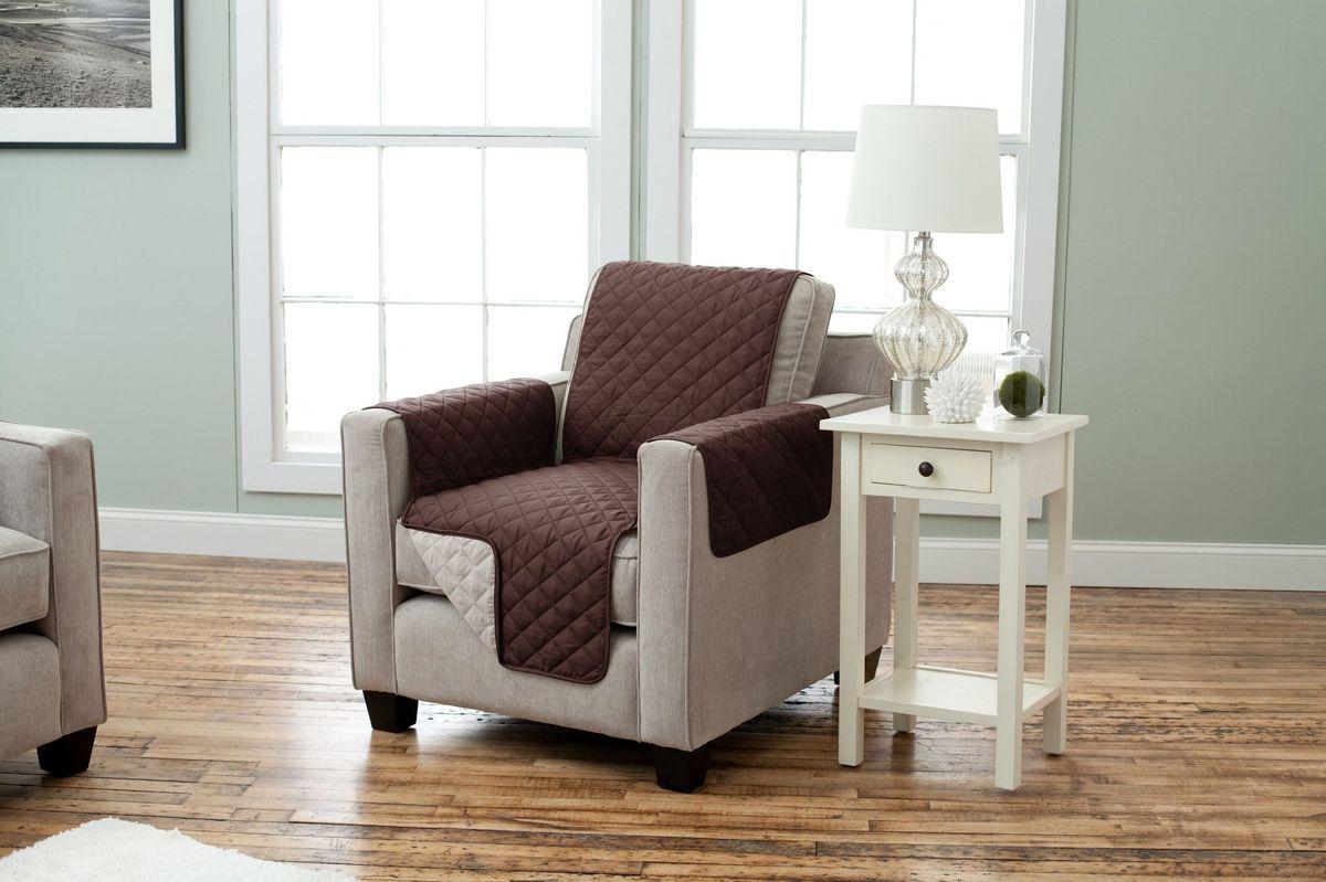 Чехол на кресло Медежда Йорк, двухсторонний, цвет: шоколадный, бежевый1601121211002Практичный двухсторонний чехол на кресло Медежда Йорк, изготовленный из прочной стеганой микрофибры, идеально подходит для создания комфорта и уюта в повседневной жизни. Благодаря ремешку и резинке чехол не будет сползать со спинки кресла, а дополнительные фиксаторы, входящие в комплект позволят плотно закрепить его между спинкой и сидением. такой чехол - стильное решение, которое защитит вашу мебель от шерсти домашних животных, пятен и износа. Характеристики:Состав: 100%полиэстер. Ширина чехла: 55 см.