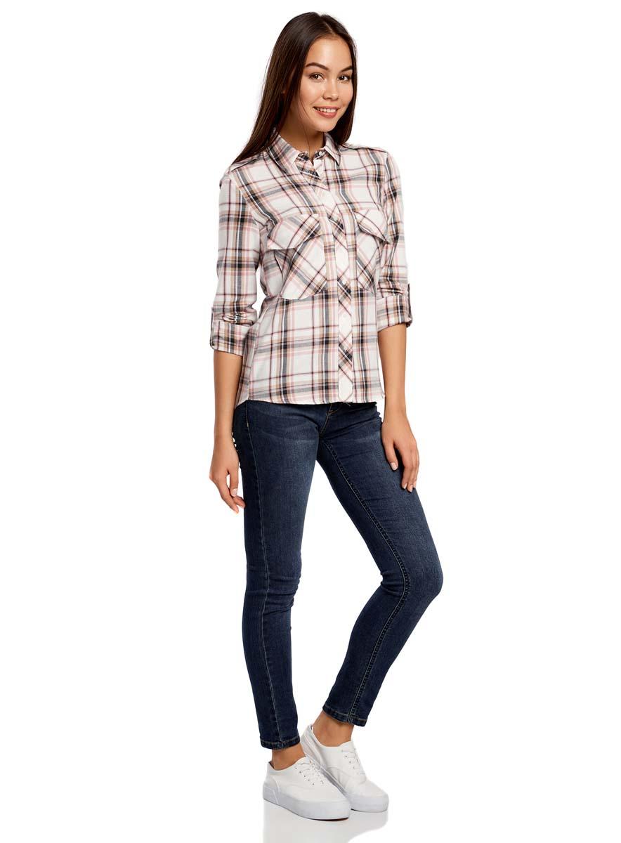 Рубашка женская oodji, цвет: белый, темно-синий, бледно-розовый. 11411052-2/45624/7912C. Размер 34 (40-170)11411052-2/45624/7912CБлузка oodji, выполненная из хлопка и полиуретана, оформлена принтом в мелкий горох. Модель с отложным воротником и длинным рукавом застегивается с помощью пуговиц. На лицевой стороне расположены два накладных кармана с клапанами. Рукава подворачиваются до локтя и фиксируются хлястиком с пуговицей.