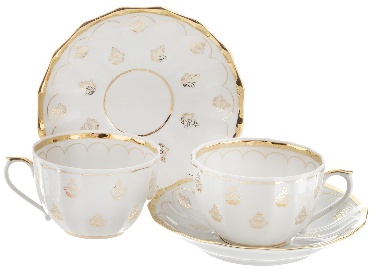 Набор чайный Фарфор Вербилок Королевский, 4 предмета2057780ПЧайный набор Фарфор Вербилок Королевский состоит из 2 чашек и 2 блюдец, которые изготовлены из высококачественного фарфора и украшены красивым рисунком. Несмотря на то, что фарфор легкий и тонкий, он отличается необычайной прочностью и долговечностью. Изысканный утонченный дизайн придется по вкусу ценителям классики и тем, кто предпочитает современный стиль.Чайный набор Королевский украсит ваш кухонный стол, а также станет замечательным подарком к любому празднику.Диаметр чашки (по верхнему краю): 8,5 см.Высота чашки: 5,5 см.Диаметр блюдца: 14,5 см.Высота блюдца: 2,5 см.