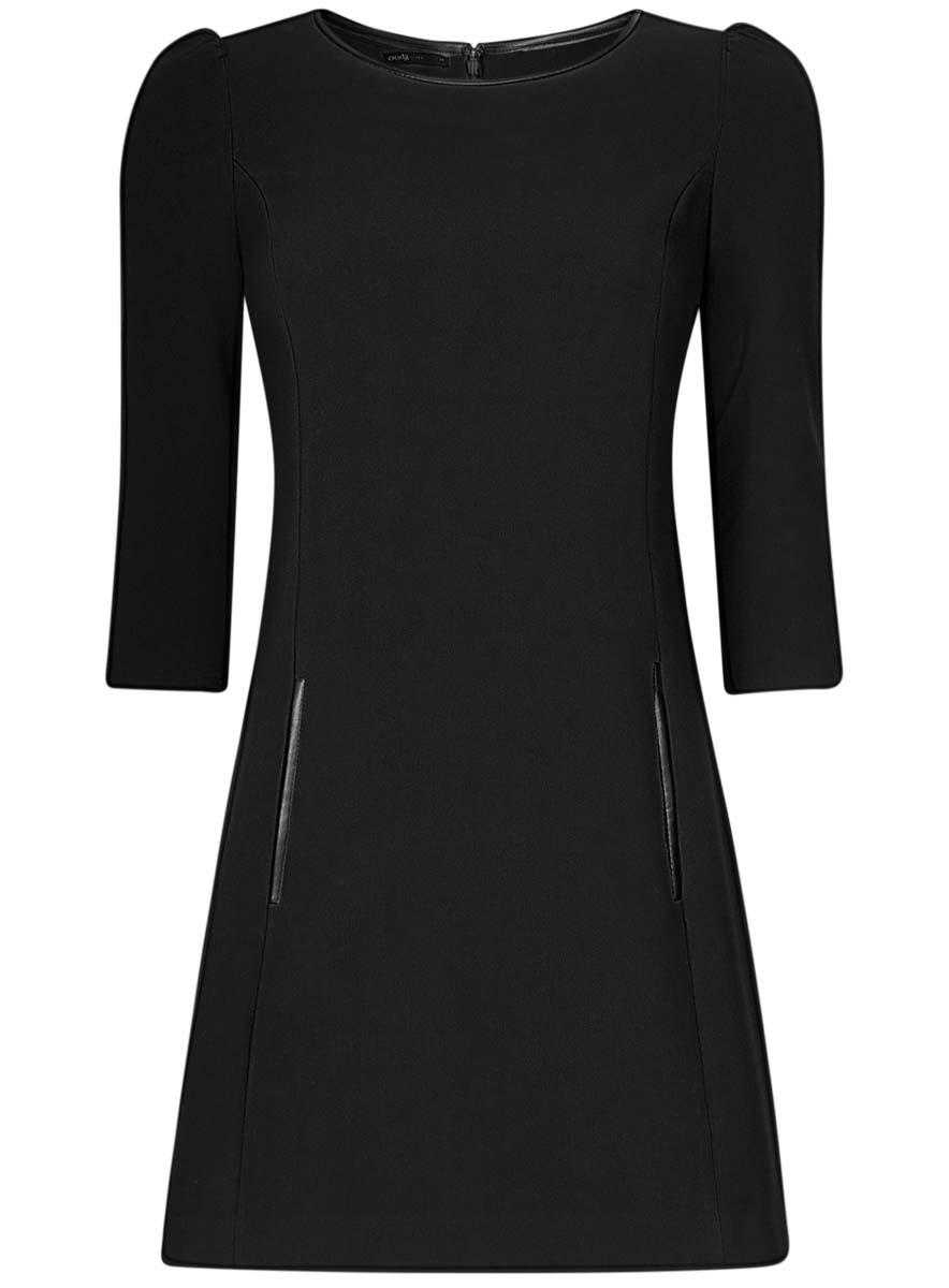 Платье oodji Ultra, цвет: черный. 11902145-1/38248/2900N. Размер 42 (48-170)11902145-1/38248/2900NМодное платье oodji Ultra станет отличным дополнением к вашему гардеробу. Модель, выполненная из полиэстера с добавлением вискозы и полиуретана, дополнена вставками из искусственной кожи. Платье-миди с круглым вырезом горловины и рукавами 3/4 спереди дополнено втачными карманами.