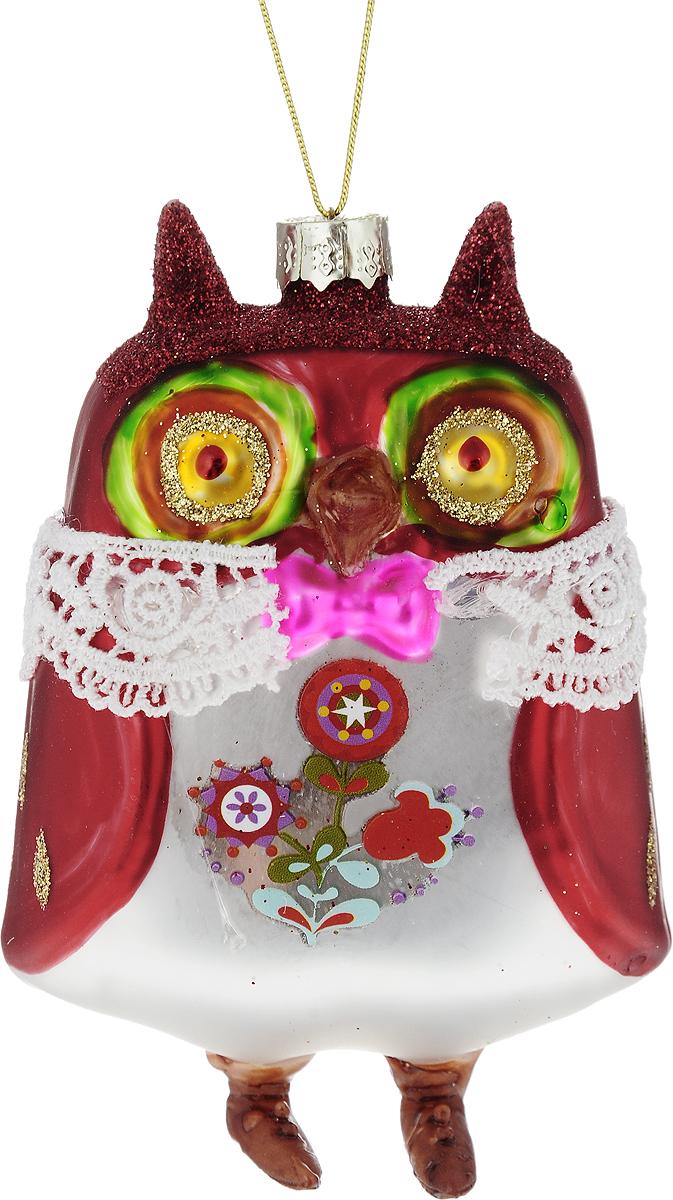 Украшение новогоднее подвесное Winter Wings Сова в костюме, 10 х 7 х 5 смN079067Новогоднее подвесное украшение Winter Wings Сова в костюмевыполнено из стекла в виде совы и украшено блестками. С помощьюспециальной петельки украшение можно повесить в любом понравившемся вамместе. Но, конечно, удачнее всего оно будет смотреться на праздничной елке.Елочная игрушка - символ Нового года. Она несет в себе волшебство и красотупраздника. Создайте в своем доме атмосферу веселья и радости, украшаяновогоднюю елку нарядными игрушками, которые будут из года в год накапливатьтеплоту воспоминаний.