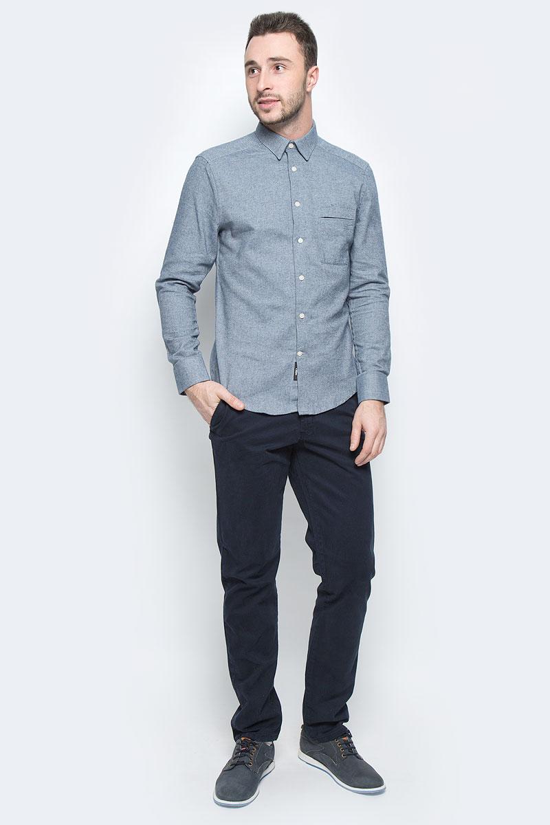 Рубашка мужская Mexx, цвет: серо-синий. MX3026670_MN_SHG_010. Размер XL (54)MX3026670_MN_SHG_010Мужская рубашка Mexx выполнена из натурального хлопка. Модель с отложным воротником и длинными рукавами застегивается на пуговицы по всей длине. Низ рукавов дополнен манжетами на пуговицах. Спереди расположен небольшой накладной карман. Рубашка оформлен принтом в меткий рубчик и дополнена фирменной нашивкой.
