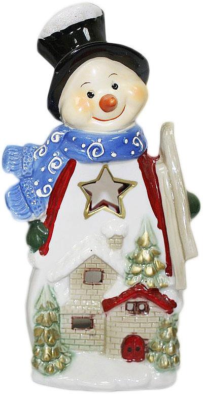Подсвечник Lillo, цвет: красный, белый, синий, высота 24 см. 2011120820111208Подсвечник Lillo, выполненный из керамики, украсит интерьер вашего дома или офиса. Оригинальный дизайн и красочное исполнение создадут праздничное настроение. Подсвечник выполнен в форме снеговика.Вы можете поставить подсвечник в любом месте, где он будет удачно смотреться, и радовать глаз. Кроме того - это отличный вариант подарка для ваших близких и друзей в преддверии Нового года.
