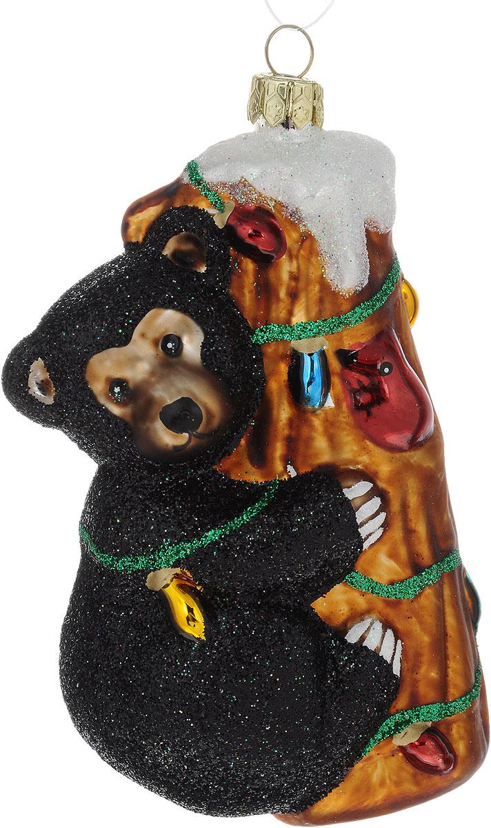 Украшение новогоднее подвесное Winter Wings Бурый мишка, высота 10,5 смN07809Новогоднее подвесное украшение Winter Wings Бурый мишка выполнено из стекла. С помощью специальной петельки украшение можно повесить в любом понравившемся вам месте. Но, конечно, удачнее всего оно будет смотреться на праздничной елке.Елочная игрушка - символ Нового года. Она несет в себе волшебство и красоту праздника. Создайте в своем доме атмосферу веселья и радости, украшая новогоднюю елку нарядными игрушками, которые будут из года в год накапливать теплоту воспоминаний.Размер: 6,5 х 5 х 10,5 см.