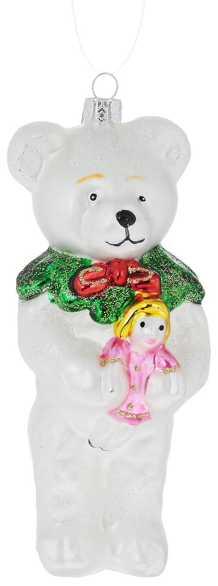 Украшение новогоднее подвесное Winter Wings Белый мишка, 5,5 х 5,5 х 15 смN07799Украшение Winter Wings Белый мишка прекрасно подойдет для праздничного декора новогодней ели. Изделие выполнено из высококачественного стекла и украшено блестками. Для удобного размещения на елке предусмотрена петелька.Елочная игрушка - символ Нового года. Она несет в себе волшебство и красоту праздника. Создайте в своем доме атмосферу веселья и радости, украшая новогоднюю елку нарядными игрушками, которые будут из года в год накапливать теплоту воспоминаний.