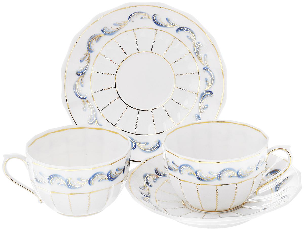 Набор чайный Фарфор Вербилок Синяя птица, 4 предмета2559780ПЧайный набор Фарфор Вербилок Синяя птица состоит из 2 чашек и 2 блюдец, изготовленных из высококачественного фарфора. Такой набор прекрасно дополнит сервировку стола к чаепитию, а также станет замечательным подарком для ваших друзей и близких. Объем чашки: 200 мл. Диаметр чашки (по верхнему краю): 9 см. Высота чашки: 5,5 см. Диаметр блюдца: 14,5 см.Высота блюдца: 2,5 см.