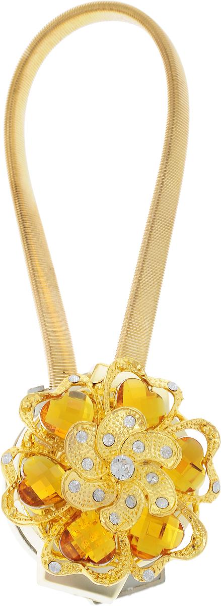 Подхват для штор TexRepublic Ajur. Rezinka, на магнитах, цвет: золотой. 7896378963Изящный подхват для штор TexRepublic Ajur. Rezinka, выполненный из пластика и металла, можно использовать как держатель для штор или для формирования декоративных складок на ткани. С его помощью можно зафиксировать шторы или скрепить их, придать им требуемое положение, сделать симметричные складки. Благодаря магнитам подхват легко надевается и снимается.Подхват для штор является универсальным изделием, которое превосходно подойдет для любых видов штор. Подхваты придадут шторам восхитительный, стильный внешний вид и добавят уют в интерьер помещения.Длина подхвата: 25 см.Диаметр: 4,5 см.
