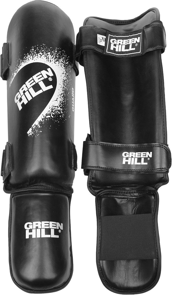 Защита голени и стопы Green Hill Guard, цвет: черный, белый. Размер XL. SIG-0012SIG-0012Защита голени и стопы Green Hill Guard с наполнителем, выполненным из вспененного полимера, необходима при занятиях спортом для защиты пальцев и суставов от вывихов, ушибов и прочих повреждений. Накладки выполнены из высококачественной искусственной кожи. Они прочно фиксируются за счет эластичной ленты и липучек.Удобные и эргономичные накладки Green Hill Guard идеально подойдут для занятий тхэквондо и другими видами единоборств.Длина голени: 37 см.Ширина голени: 13 см.Длина стопы: 17 см.Ширина стопы: 11,5 см.