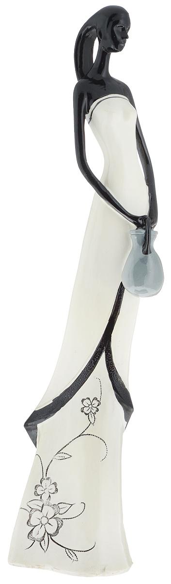 Фигурка декоративная Gotoff, высота 33 см3DL-H7011Декоративная фигурка Gotoff, изготовленная из высококачественной керамики, выполнена в виде девушке в вечернем платье. Вы можете поставить фигурку в любом месте, где она будет удачно смотреться и радовать глаз. Сувенир отлично подойдет в качестве подарка близким или друзьям.