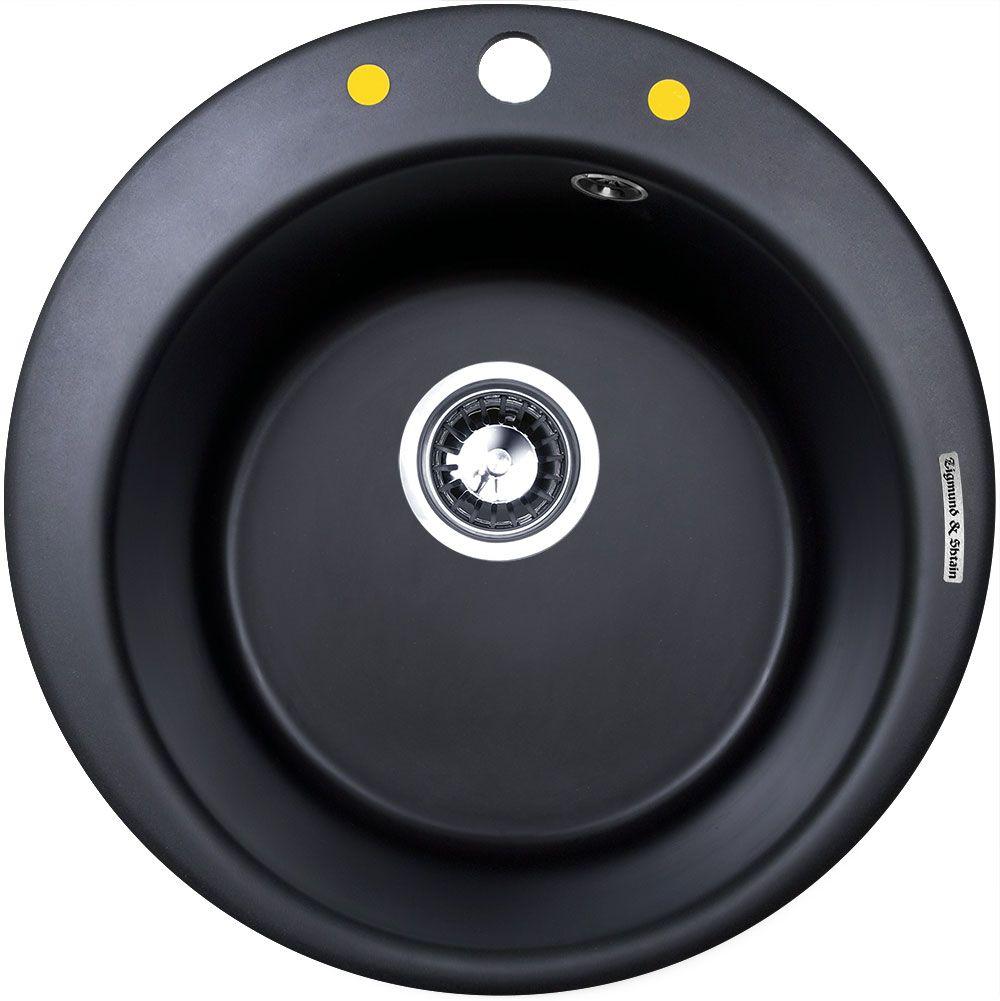 Мойка Zigmund & Shtain Kreis 480, врезная, цвет: черный базальт, диаметр 37 смkreis480Мойка для кухни Zigmund & Shtain с врезной установкой выполнена из искусственного гранита круглой формы.Врезная мойка монтируется в уже подогнанную под нее столешницу или тумбу. Своей верхней цельнометаллической кромкой она плотно прижимается к поверхности тумбы (столешницы).Модель Kreis 480 - является прекрасным решением для небольших кухонь. Круглая форма отлично впишется в любой интерьер. При небольших внешних габаритах, чаша мойки позволяет вымыть большую кастрюлю, или пару сковородок разом. В том числе вам не придется волноваться за плотность прилегания мойки к столешнице, в комплект входит крепежная арматура Hettich которая обеспечивает надежное крепление к поверхности, на протяжении всего срока службы. Благодаря особой системе производства, мойка не способна навредить здоровью человека. Для монтажа в комплекте предусмотрены качественные крепежи и дополнительные элементы.Общий размер: 48 х 48 см. Внутренний размер чаши: 37 см. Глубина чащи: 19 см. Ширина шкафа: 45 см.