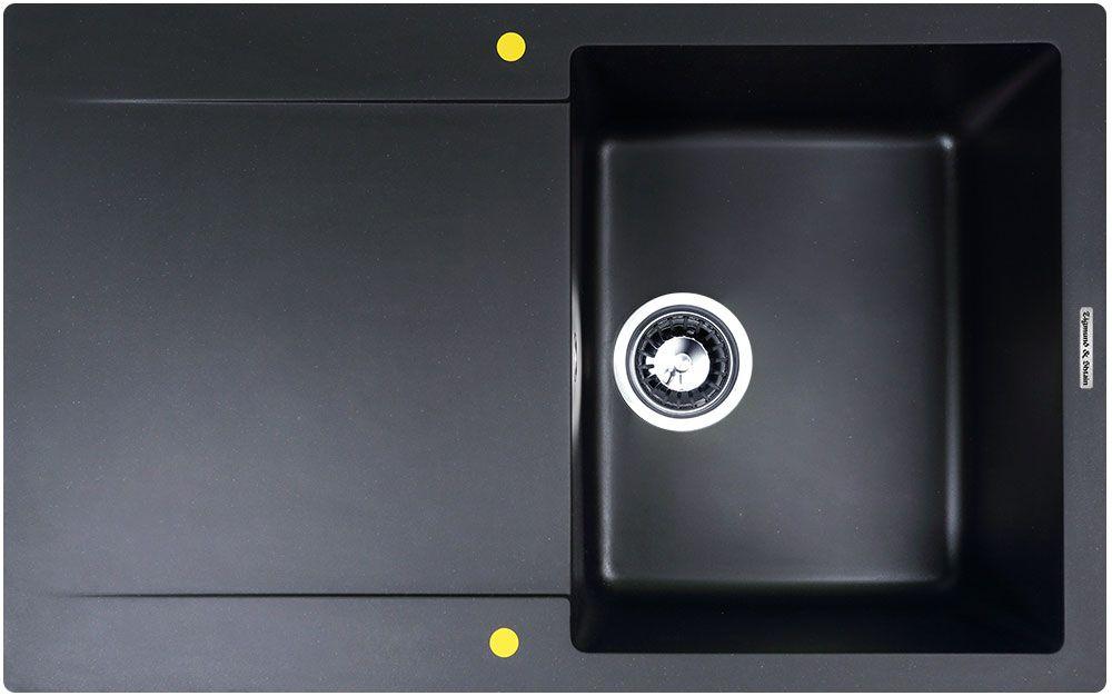 Мойка Zigmund & Shtain Rechteck 775, врезная, с крылом, цвет: черный базальт, 34 х 42 смrechteck775Выполненная из качественного гранита мойка для кухни Zigmund & Shtain Rechteck 775 является универсальной и очень многофункциональной моделью. Оптимальные размеры в сочетании с глубиной чаши, идеально объединяются между собой, обеспечивая удобный подход к раковине и простор для работы. В ней комфортно мыть посуду любой высоты: будь то кастрюли или различного вида чайники, в том числе, в чашу без труда умещаются большие объемы малогабаритной посуды. Сбоку раковины располагается широкое, массивное крыло, на котором легко поместится все необходимое: от губок, моющих средств и дозаторов к чистящим средствам, до большого количества вымытой посуды, в том числе крупногабаритной. Вы можете абсолютно спокойно оставлять на крыле мойки свежие овощи, фрукты и ягоды для предварительного стекания воды, или мясо, курицу, рыбу для разморозки, так как структура гранитной мойки монолитна и не впитывает в себя натуральные красители. Врезная мойка монтируется в уже подогнанную под нее столешницу или тумбу. Своей верхней цельнометаллической кромкой она плотно прижимается к поверхности тумбы (столешницы). Для монтажа в комплекте предусмотрены качественные крепежи и дополнительные элементы. Общий размер: 77,5 х 49,5 см.Внутренний размер чаши: 34 х 42 см.Глубина чащи: 18 см.Ширина шкафа: 45 см.