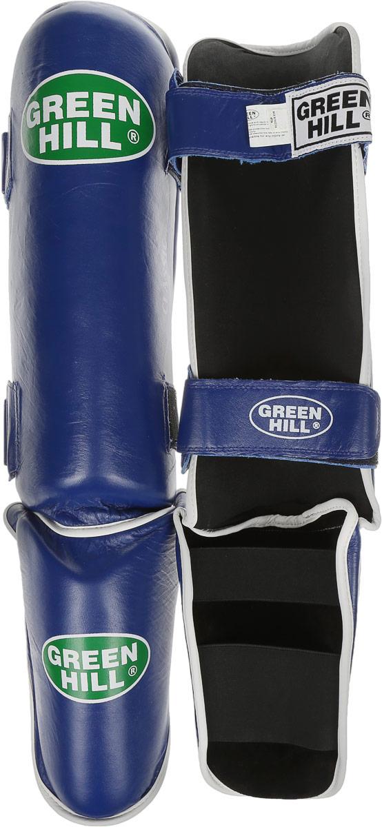 Защита голени и стопы Green Hill Classic, цвет: синий, черный. Размер XL. G-0019SL536105Защита голени и стопы Green Hill Classic с наполнителем, выполненным из вспененного полимера, необходима при занятияхспортом для защиты пальцев и суставов от вывихов, ушибов и прочих повреждений.Накладки выполнены из высококачественной натуральной кожи. Они надежно фиксируются за счет ленты и липучек. Удобные и эргономичные накладки Green Hill Classic идеально подойдут для занятий тхэквондо и другими видами единоборств. Длина голени: 37 см. Ширина голени: 16 см. Длина стопы: 21 см. Ширина стопы: 12 см.
