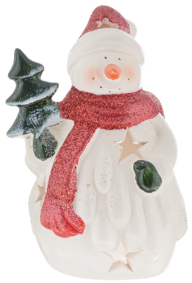 Подсвечник House & Holder, высота 14 смYM082205Подсвечник House & Holder, выполненный из керамики, украсит интерьер вашего дома или офиса. Оригинальный дизайн создаст праздничное настроение. Подсвечник выполнен в виде снеговика и оснащен перфорацией.Вы можете поставить подсвечник в любом месте, где он будет удачно смотреться, и радовать глаз. Кроме того - это отличный вариант подарка для ваших близких и друзей.