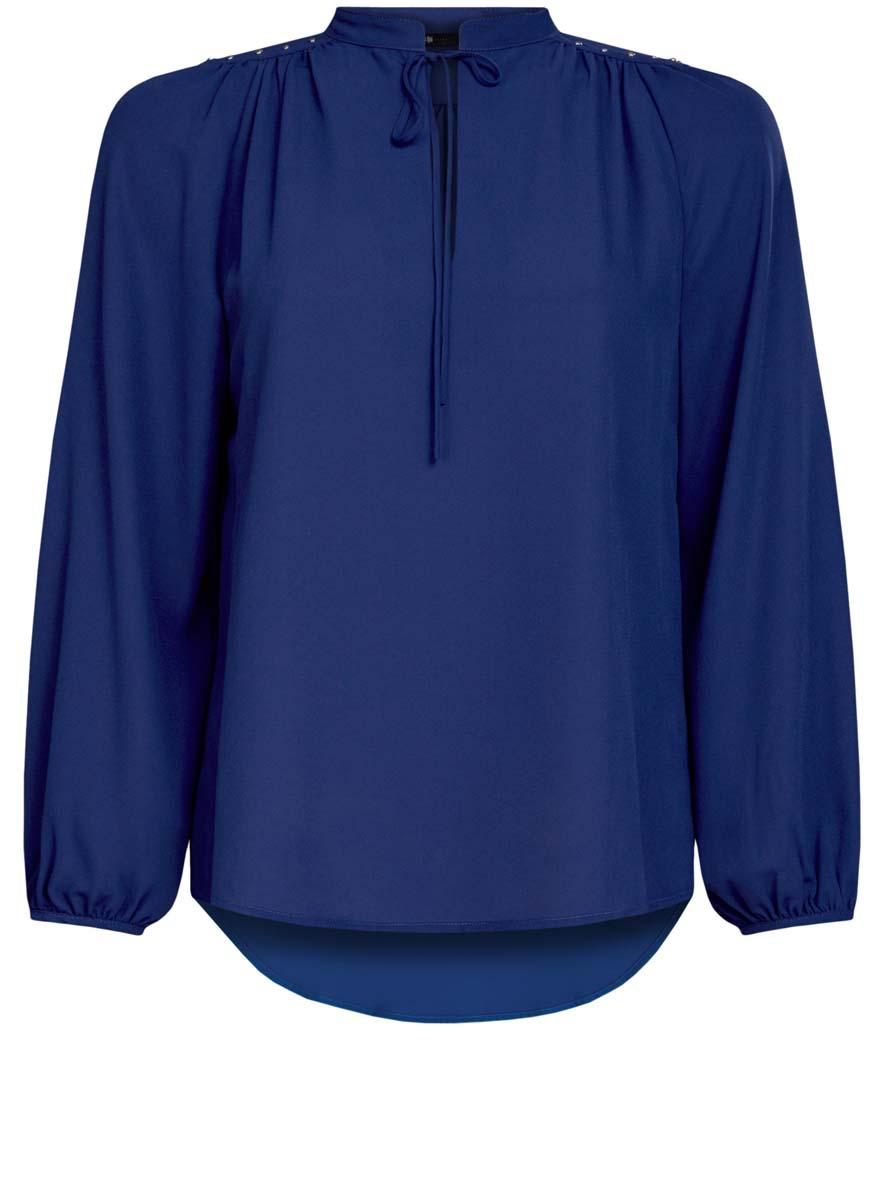 Блузка женская oodji Ultra, цвет: синий. 11411126/45873/7500N. Размер 38 (44-170)11411126/45873/7500NЖенская блузка oodji Ultra имеет свободный крой, воротник-стойку оформленный завязками и вырезом-капелькой,рукава-баллоны. Изделие декорировано металлическими кнопками по плечам. Блузка имеет скругленный низ, удлинена сзади.