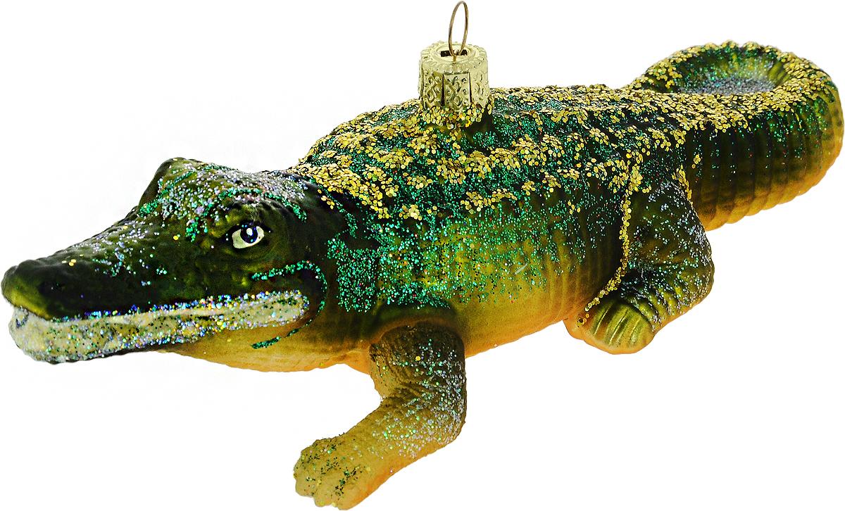 Украшение новогоднее подвесное Winter Wings Крокодил, длина 14 смN07808Новогоднее украшение Winter Wings Крокодил выполнено из стекла. С помощью специальной петельки украшение можно повесить в любом понравившемся вам месте. Но, конечно, удачнее всего оно будет смотреться на праздничной елке.Елочная игрушка - символ Нового года. Она несет в себе волшебство и красоту праздника. Создайте в своем доме атмосферу веселья и радости, украшая новогоднюю елку нарядными игрушками, которые будут из года в год накапливать теплоту воспоминаний.