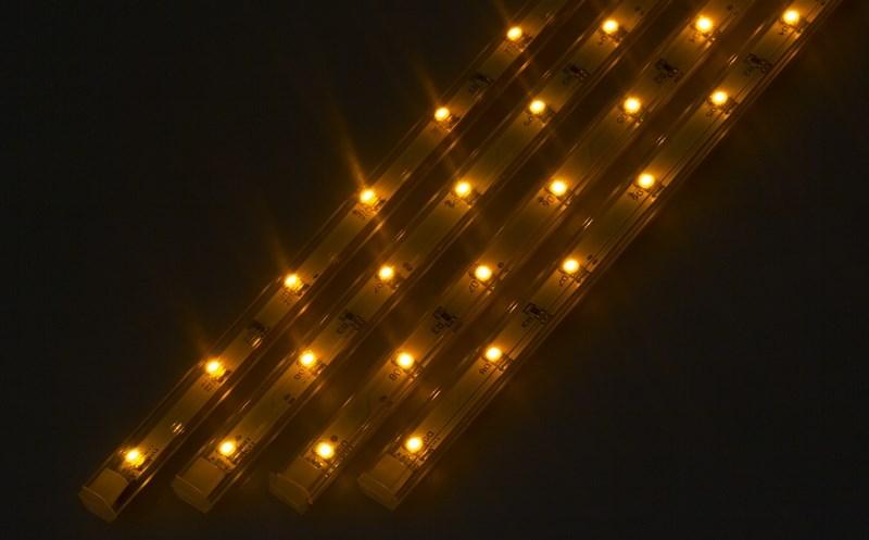 Светодиодный светильник Neon-Night, линейный, 4 шт х 25 см, цвет: желтый145-102Линейный светодиодный светильник Neon-Night - это светодиодная линейка длиной 25 см, заключенная в корпус из прозрачного пластика. Онимогут использоваться в подсветке витрин, мебели, а так же в интерьерной подсветке. Простота монтажа поможет без проблем справиться свопросом освещения необходимых зон. Блок питания, понижающий напряжение до 12 В, делает устройство безопасным в использовании.Использование светодиодных светильников является выгодным решением, так как они обладают высокой яркостью свечения, большим срокомслужбы и вместе с этим низким энергопотреблением. Поставляется по 4 штуки в комплекте с блокомпитания.