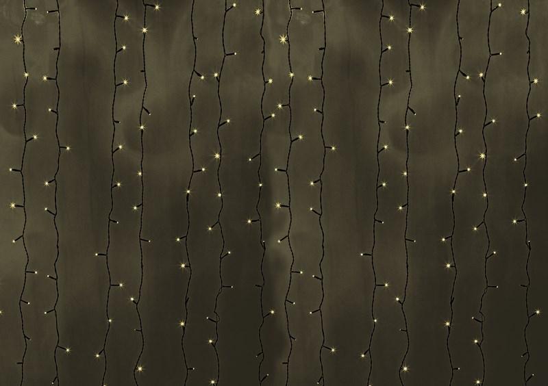 Гирлянда Neon-Night Светодиодный Дождь, постоянное свечение, цвет: черный, теплый белый, 2 х 3 м235-146Гирлянда Светодиодный Дождь представляет собой гибкий горизонтальный шнур-шину (2м), к которому через определенные промежутки крепятся вертикальные нити (20 шт.) со светодиодными лампами, которые отличаются от «Бахромы» тем, что имеют одинаковую, достаточно значительную длину, часто превышающую протяженность шины. На концах каждой шины есть разъем и штепсель, которые предназначены для последовательного соединения нескольких световых дождей в большой занавес ПЛЕЙ-ЛАЙТ. Используя занавес, можно не только создавать красивые световые занавесы или оформлять различные плоскости, например, фасады домов, окна и т.д., но и украшать объемные объекты. Гирлянду, работающую в непрерывном свечении, называют фиксинг, а использующую режим светодинамики – чейзинг. Светодинамические эффекты становятся доступными только при подключении гирлянды к сети через специальный контроллер.Сегодня в гирляндах источником света служат светодиоды, которые пришли на смену применявшимся ранее лампам накаливания. С полупроводниковыми источниками гирлянда стала более надежной, потребляет меньше энергии, обрела более насыщенное сияние. Данная гирлянда имеет теплый белый цвет свечения светодиодов.